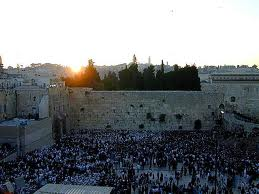 The Western Wall in the golden rays of the rising sun.