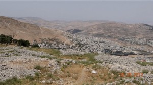 The ancient Samaritan village of Sychar lies at the base of Mt. Ebal in the far valley.