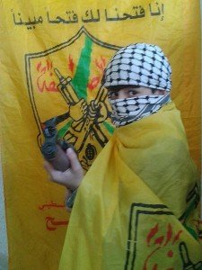 48th anniversary of Fatah celebrations featuring an armed boy