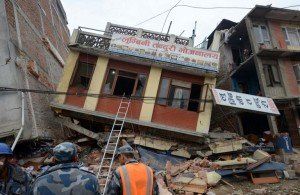 Nepalese rescue personnel observe damaged buildings following an earthquake in Kathmandu on April 26, 2015.