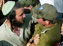 Soldiers and settlers crying together.
