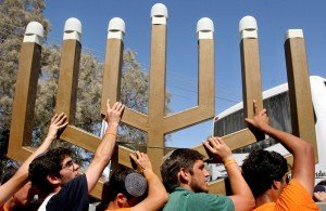 Jewish settlers remove the Menorah from the synagogue in the Netzarim settlement, in the Gaza Strip, August 22, 2005. Israeli troops marched unopposed into the Gaza Strip's last Jewish settlement to complete the evacuation of the territory after nearly four decades of occupation.
