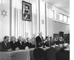 Independence Hall where Israel's Declaration of Independence was signed on May 14, 1948. Ben Gurion stands, reading the Declaration.